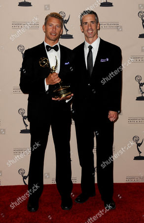 "SEPTEMBER 15: (L-R) Terry Miller and Dan Savage, winners of the Governors Award for ""It Gets Better Project"" pose in the press room at the Academy of Television Arts & Sciences 64th Primetime Creative Arts Emmy Awards at Nokia Theatre L.A. Live on in Los Angeles, California"