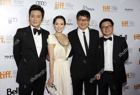 """Chinese actors Jang Dong-gun, left, and Zhang Ziyi pose with director Hur Jin-Ho and producer Wei Ming Chen, right, at the premiere for """"Dangerous Liaisons"""" during the Toronto International Film Festival on in Toronto"""
