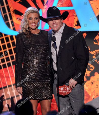 Trevor Brazile, right, and Shada Brazile present the male artist of the year award onstage at the American Country Awards at the Mandalay Bay Resort & Casino, in Las Vegas, Nev