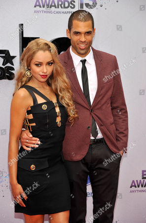 Kat Graham, left, and Cottrell Guidry arrive at the BET Awards at the Nokia Theatre, in Los Angeles