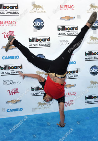Sky Blu stands on one hand as he arrives at the Billboard Music Awards at the MGM Grand Garden Arena on in Las Vegas