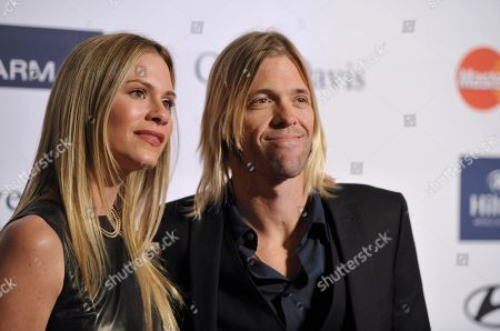 Foo Fighters drummer Taylor Hawkins, right, and Alison Hawkins arrives at the Clive Davis Pre-GRAMMY Gala on in Beverly Hills, Calif