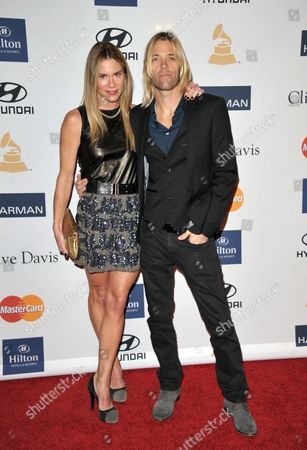 Foo Fighters drummer Taylor Hawkins, right, and Alison Hawkins arrive at the Clive Davis Pre-GRAMMY Gala on in Beverly Hills, Calif