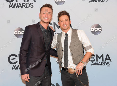 Eric Gunderson, left, and Stephen Barker Liles, of Love and Theft arrive at the 47th annual CMA Awards at Bridgestone Arena, in Nashville, Tenn