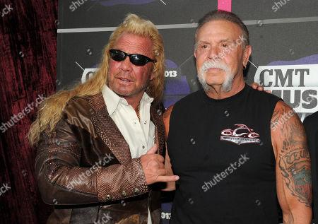 "Duane ""Dog"" Chapman, left, and Paul Teutul, Sr. arrive at the 2013 CMT Music Awards at Bridgestone Arena, in Nashville, Tenn"