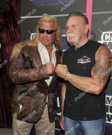 "Duane ""Dog"" Chapman, left, and Paul Teutul, Sr. arrive at the 2013 CMT Music Awards at Bridgestone Arena, in Nashville, Tenn"