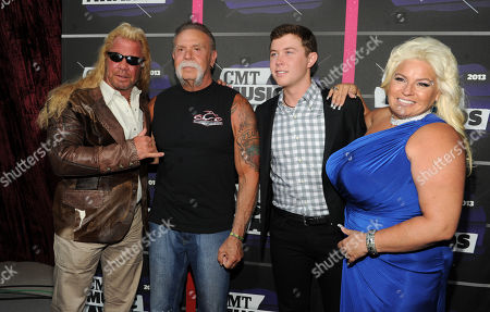 "Stock Image of From left, Duane ""Dog"" Chapman, Paul Teutul, Sr., Scotty McCreery and Beth Chapman arrive at the 2013 CMT Music Awards at Bridgestone Arena, in Nashville, Tenn"