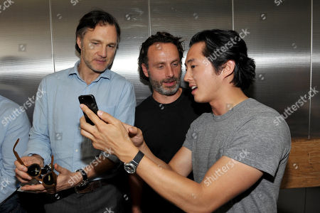 From left, David Morrissey, Andrew Lincoln and Steven Yeun attend AMC's 'The Walking Dead' panel, on in San Diego, Calif