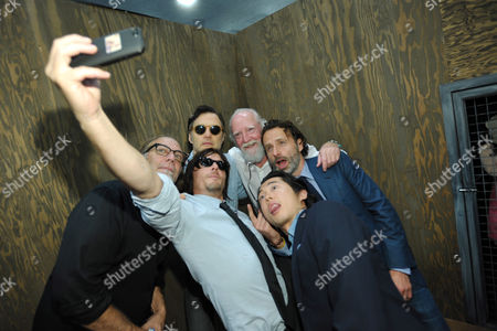 Stock Image of From left back row, executive producer Gregory Nicotero, David Morrissey, Scott Wilson and Andrew Lincoln. From left front row, Norman Reedus and Steven Yeun take a photo at AMC's 'The Walking Dead' booth signing, on in San Diego, Calif