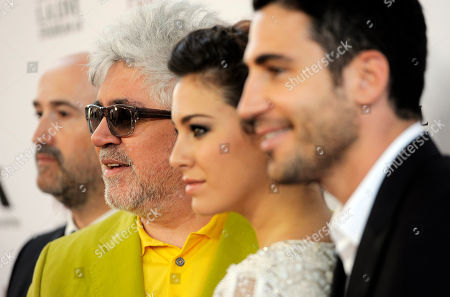 """Stock Image of Pedro Almodovar, second from left, director of """"I'm So Excited,"""" poses with cast members, left to right, Javier Camara, Blanca Suarez and Miguel Silvestre at the Los Angeles Film Festival's premiere of the film at the Regal Cinemas at LA LIVE on in Los Angeles"""
