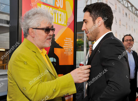 """Pedro Almodovar, left, director of """"I'm So Excited,"""" mingles with cast member Miguel Silvestre at the Los Angeles Film Festival's premiere of the film at the Regal Cinemas at LA LIVE on in Los Angeles"""