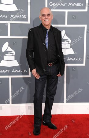 Larry Carlton arrives at the 55th annual Grammy Awards, in Los Angeles