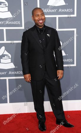 Claude Kelly arrives at the 55th annual Grammy Awards, in Los Angeles