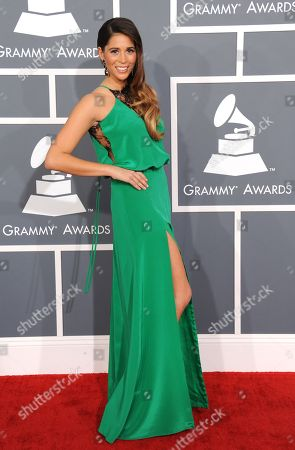 Ali Tamposi arrives at the 55th annual Grammy Awards, in Los Angeles