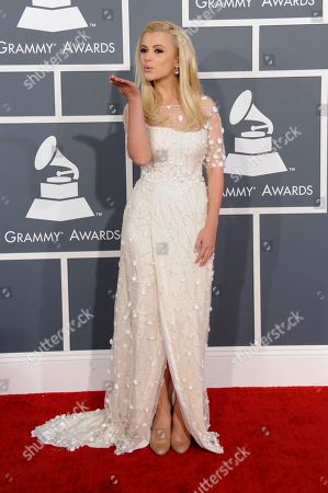 Mika Newton arrives at the 55th annual Grammy Awards, in Los Angeles