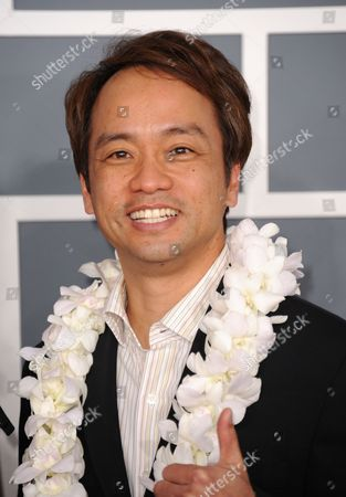 Daniel Ho arrives at the 55th annual Grammy Awards, in Los Angeles