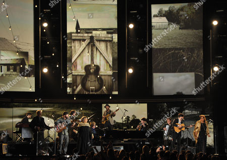 Artists perform a tribute to Levon Helm at the 55th annual Grammy Awards, in Los Angeles