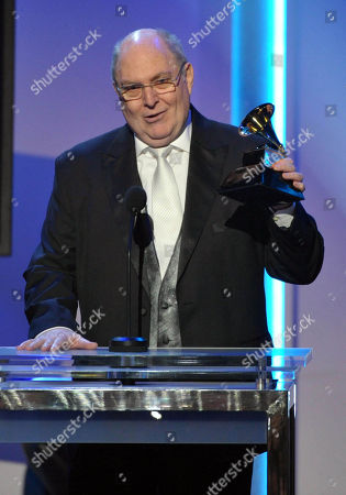 "Billy Vera accepts the award for the best album notes for ""Singular Genius: The Complete ABC Singles"" during the pre-telecast at the 55th annual Grammy Awards, in Los Angeles"