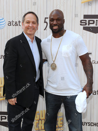 Stock Image of Kevin Kay, left, president of Spike TV, and Muhammed Lawal arrive at Spike TV's Guys Choice Awards at Sony Pictures Studios, in Culver City, Calif