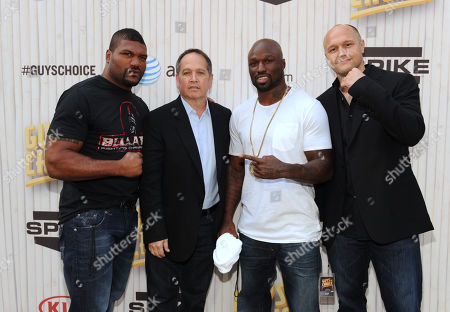 From left, Quinton Jackson, Kevin Kay, president of Spike TV, Muhammed Lawal and Jimmy Smith arrive at Spike TV's Guys Choice Awards at Sony Pictures Studios, in Culver City, Calif