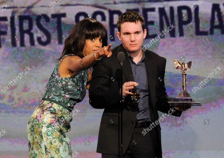 Actress Kerry Washington presents Derek Connolly with the best first screenplay award at the Independent Spirit Awards, in Santa Monica, Calif