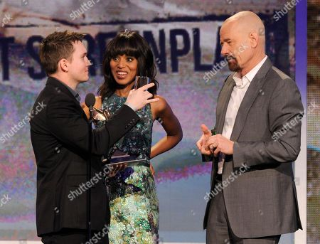 Actors Kerry Washington, center, and Bryan Cranston, right, present Derek Connolly with the best first screenplay award at the Independent Spirit Awards, in Santa Monica, Calif