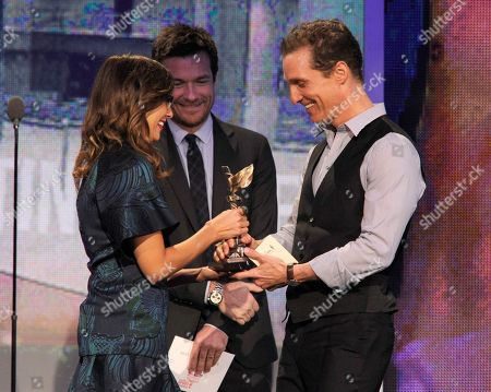 """Actors Rashida Jones, left, and Jason Bateman present actor Matthew McConaughey, right, the award for best supporting male for """"Magic Mike"""" at the Independent Spirit Awards, in Santa Monica, Calif"""