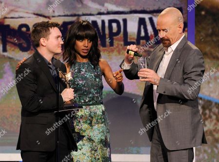 Actors Kerry Washington and Bryan Cranston present Derek Connolly with the best first screenplay award at the Independent Spirit Awards, in Santa Monica, Calif