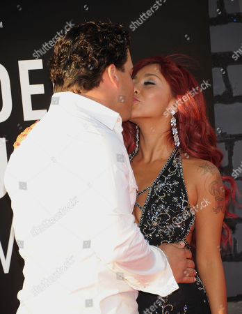 """Stock Picture of Jionni LaValle, left, and Nicole """"Snooki"""" Polizzi arrive at the MTV Video Music Awards, at the Barclays Center in the Brooklyn borough of New York"""