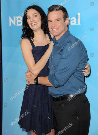 """Joanne Kelly, left, and Eddie McClintock of Syfy's """"Warehouse 13"""" arrive at the 2013 NBCUniversal Summer Press Day at The Langham Huntington Hotel and Spa on in Pasadena, Calif"""