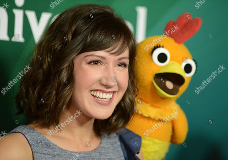 """Kelly Vrooman, left, and Chica the Chicken of """"The Chica Show"""" arrive at the 2013 NBCUniversal Summer Press Day at The Langham Huntington Hotel and Spa on in Pasadena, Calif"""