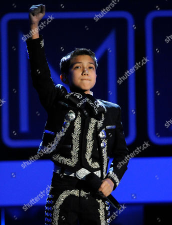 Sebastien de la Cruz sings the national anthem on stage at the NCLR ALMA Awards at the Pasadena Civic Auditorium, in Pasadena, Calif