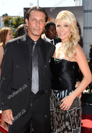 Patrick Tatopoulos, left, and McKenzie Westmore arrive at the 2013 Primetime Creative Arts Emmy Awards, on at Nokia Theatre L.A. Live, in Los Angeles, Calif