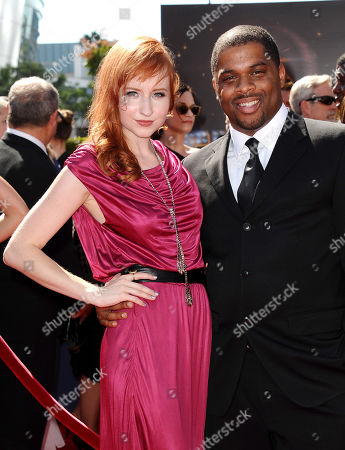 Stock Picture of From left, Mary Kate Wiles and guest arrive at the 2013 Primetime Creative Arts Emmy Awards, on at Nokia Theatre L.A. Live, in Los Angeles, Calif