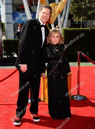 From left, Bob Bergen and June Foray arrive at the 2013 Primetime Creative Arts Emmy Awards, on at Nokia Theatre L.A. Live, in Los Angeles, Calif