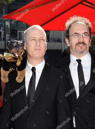 From left, Eric Slovin and Robert Smigel arrive at the 2013 Primetime Creative Arts Emmy Awards, on at Nokia Theatre L.A. Live, in Los Angeles, Calif