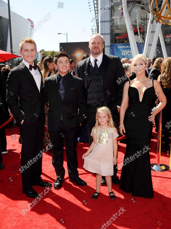 From left, Jason Dolley, Bradley Steven Perry, Eric Allan Kramer, Mia Talerico and Leigh-Allyn Baker of Good Luck Charlie arrive at the 2013 Primetime Creative Arts Emmy Awards, on at Nokia Theatre L.A. Live, in Los Angeles, Calif