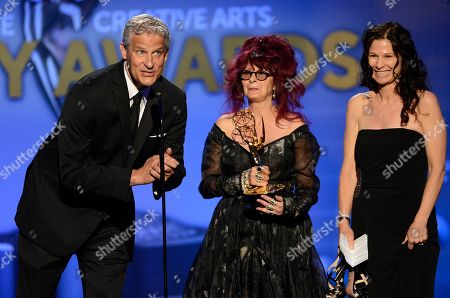 From left, Todd Kleitsch, Deborah Lamia Denaver and Deborah Rutherford accept the award for Outstanding Makeup for a Miniseries or a Movie (Non-Prosthetic) for Behind The Candelabra onstage at the 2013 Primetime Creative Arts Emmy Awards, on at Nokia Theatre L.A. Live, in Los Angeles, Calif