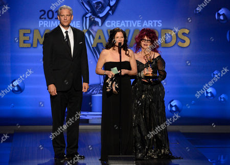 Stock Image of From left, Todd Kleitsch, Deborah Rutherford and Deborah Lamia Denaver accept the award for Outstanding Makeup for a Miniseries or a Movie (Non-Prosthetic) for Behind The Candelabra onstage at the 2013 Primetime Creative Arts Emmy Awards, on at Nokia Theatre L.A. Live, in Los Angeles, Calif