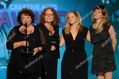 From left, Susan Lacy, Prudence Glass, Jessica Levin and Julie Sacks accept the award for Outstanding Documentary or Nonfiction Series for American Masters onstage at the 2013 Primetime Creative Arts Emmy Awards, on at Nokia Theatre L.A. Live, in Los Angeles, Calif