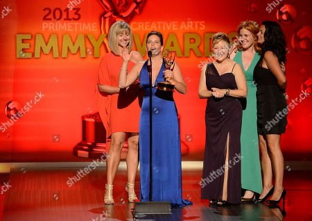 From left, Cara Hannah Sullivan, Bettie O. Rogers, Inga Thrasher, Jennifer Serio Stauffer and Jodi Mancuso accept the award for Outstanding Hairstyling for a Multi-Camera Series or Special for Saturday Night Live onstage at the 2013 Primetime Creative Arts Emmy Awards, on at Nokia Theatre L.A. Live, in Los Angeles, Calif
