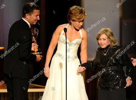 June Foray, right, accepts the Governors Award onstage at the 2013 Primetime Creative Arts Emmy Awards, on at Nokia Theatre L.A. Live, in Los Angeles, Calif