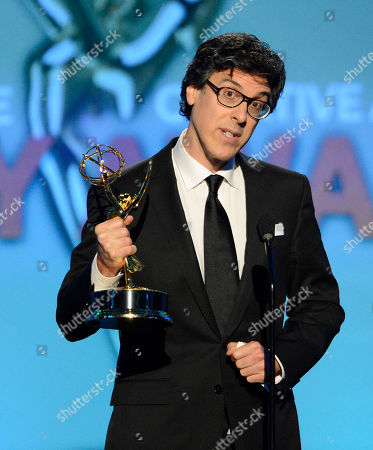 Robert Trachtenberg accepts the award for Outstanding Directing for Nonfiction Programming for American Masters onstage at the 2013 Primetime Creative Arts Emmy Awards, on at Nokia Theatre L.A. Live, in Los Angeles, Calif