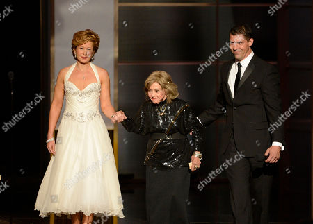 June Foray, center, accepts the Governors Award onstage at the 2013 Primetime Creative Arts Emmy Awards, on at Nokia Theatre L.A. Live, in Los Angeles, Calif