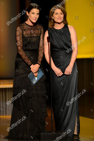 From left, Cobie Smulders and Pamela Fryman present onstage at the 2013 Primetime Creative Arts Emmy Awards, on at Nokia Theatre L.A. Live, in Los Angeles, Calif
