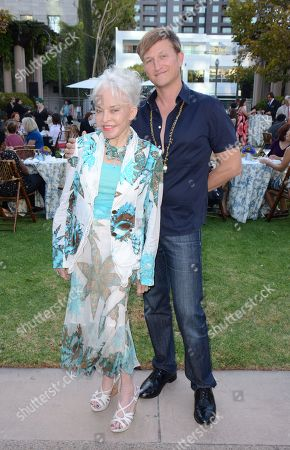 """From left, Lois Aldrin and Carlo Capomazza attend the Academy of Television Arts & Sciences 65th Primetime Emmy Awards Costume Design & Supervision Nominee Reception & 7th Annual FIDM Museum & Galleries """"The Outstanding Art of Television Costume Design"""" Exhibition Preview at the Fashion Institute of Design & Merchandising on in Los Angeles, Calif"""