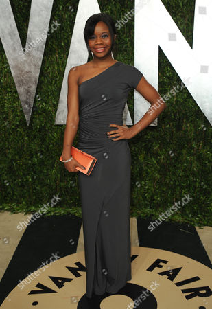 Gymnast Gabby Douglas arrives at the 2013 Vanity Fair Oscars Viewing and After Party on at the Sunset Plaza Hotel in West Hollywood, Calif