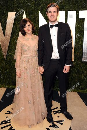 Stock Picture of From left, actress Zooey Deschanel and writer Jamie Linden arrive at the 2013 Vanity Fair Oscars Viewing and After Party on at the Sunset Plaza Hotel in West Hollywood, Calif