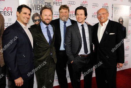 """Mark Wahlberg, second from right, star and producer of """"The Gambler,"""" poses with, left to right, producer Stephen Levinson, director Rupert Wyatt, cast member John Goodman and producer Irwin Winkler at the premiere of the film at AFI Fest 2014, in Los Angeles"""