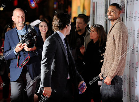 """Mark Wahlberg, center, star and producer of """"The Gambler,"""" greets fellow cast member Anthony Kelley, right, as he arrives at the premiere of the film at AFI Fest 2014, in Los Angeles"""